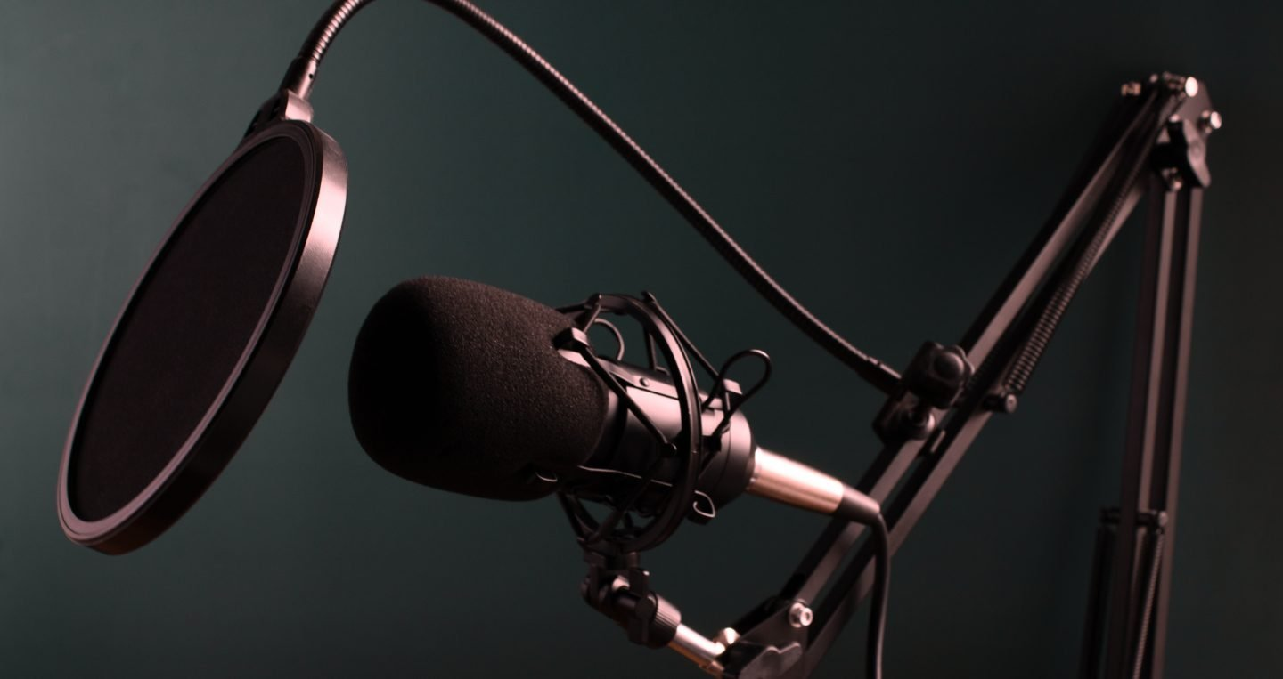 Microphone in front of blue/green background